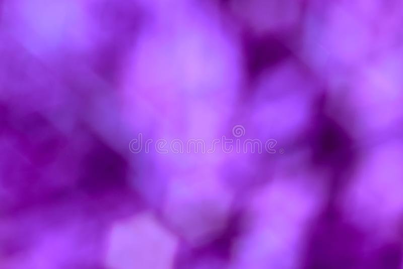 Abstract blurry purple background with geometric bokeh royalty free stock photos