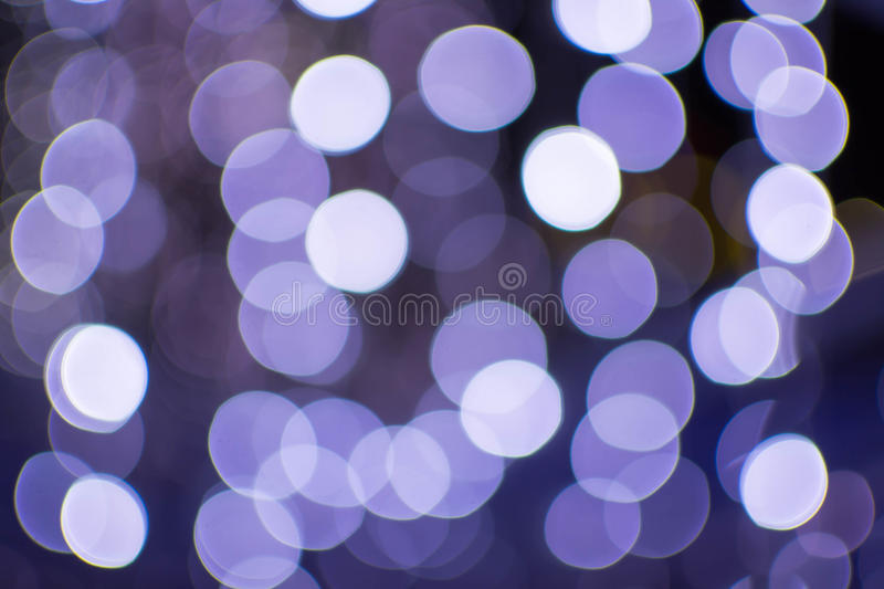 Abstract bokeh background of Christmas lights at night stock images