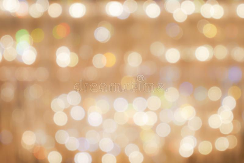 Abstract bokeh background : golden glittering festive chrismas b stock photo