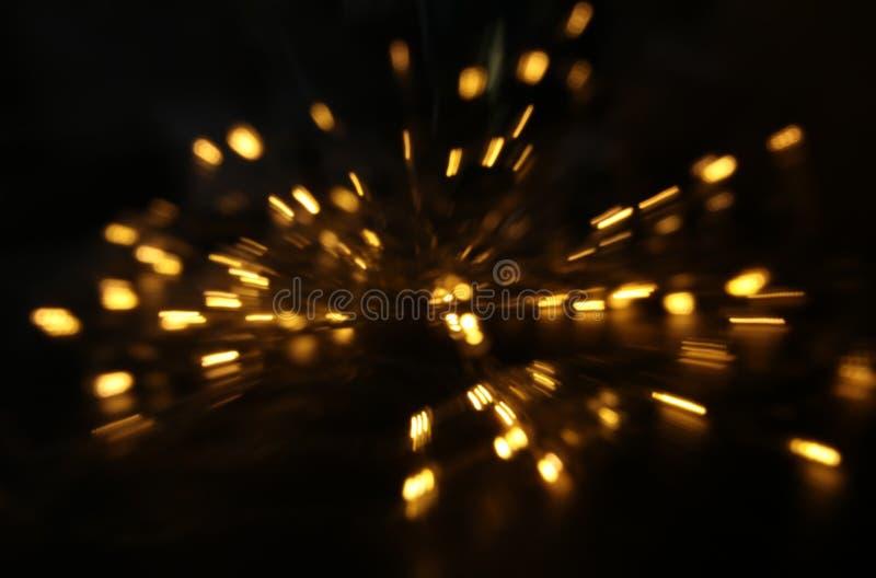 Abstract bokeh background of golden light burst made from bokeh motion.  stock image