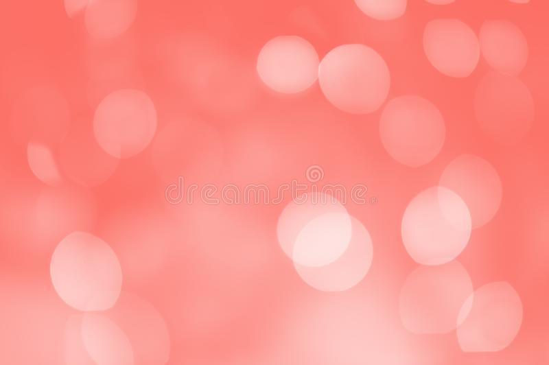 Abstract bokeh background. The lights are out of focus. Living Coral stock photography