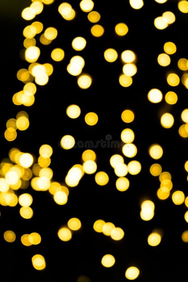 Abstract bokeh background orange gold light. Abstract bokeh background with orange gold light on black royalty free stock photo