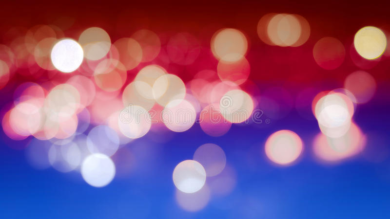 Abstract Bokeh Background with Real Defocused Lights. Abstract blur bokeh background with the colors of the American flag, real defocused lights royalty free stock image