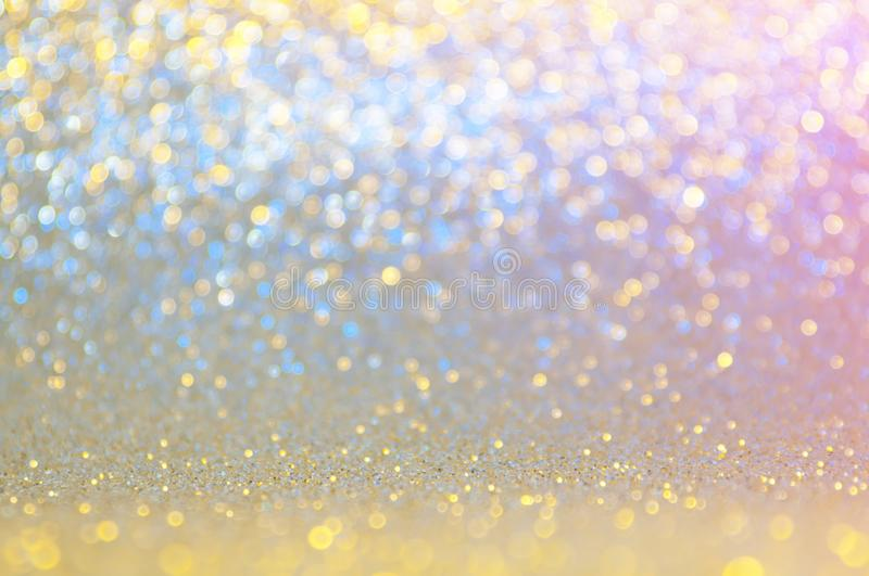 Abstract bokeh blue ,pink,gold,yellow colors with light background.Blue night light elegance,smooth sparkling glittering wallpaper royalty free stock images
