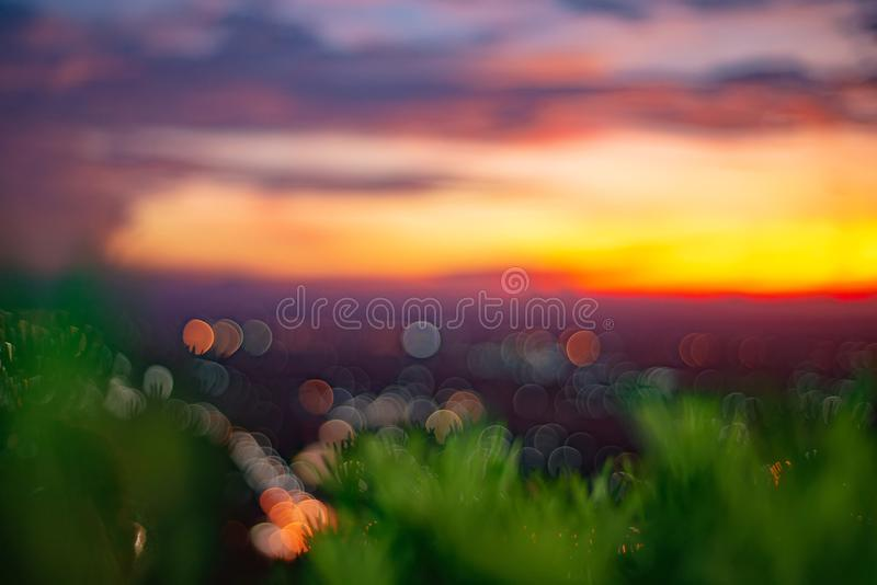 Abstract bokeh blurred from beautiful sunset at Songkhla Thailand. cityscape in the evening. stock images