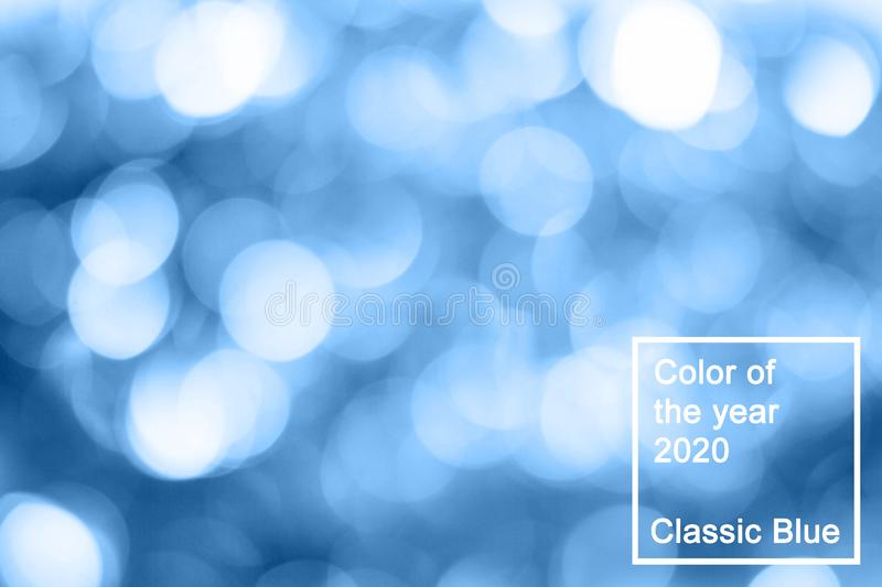 abstract with bokeh defocused lights in classic blue trendy color. background. Color of the year 2020 stock image