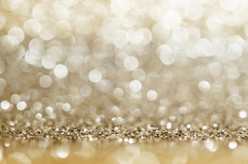 Abstract bokeh golden and yellow colors defocused circular background. Christmas light, new year or season .greeting background.  royalty free stock image