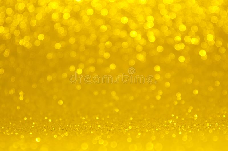 Abstract bokeh golden and yellow colors defocused circular background. Christmas light or season greeting background stock photo