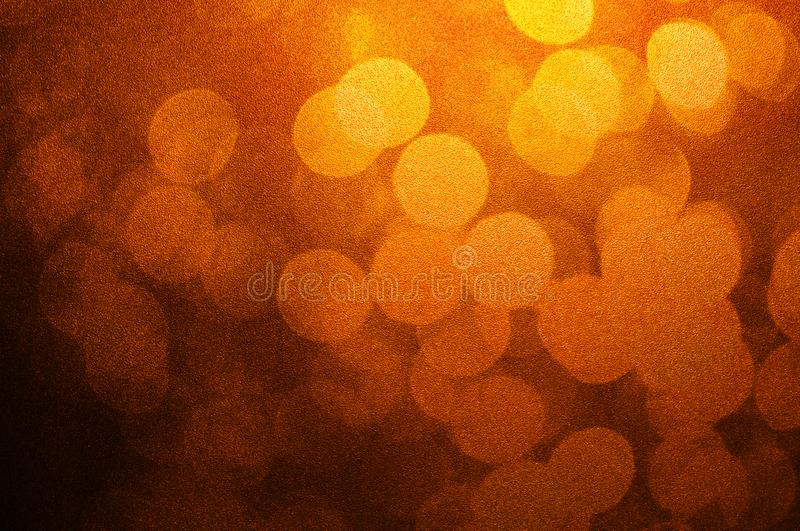 Abstract bokeh light brown and yellow colors defocused circular summer background. Christmas light or season greeting background. Double Exposure image stock photography