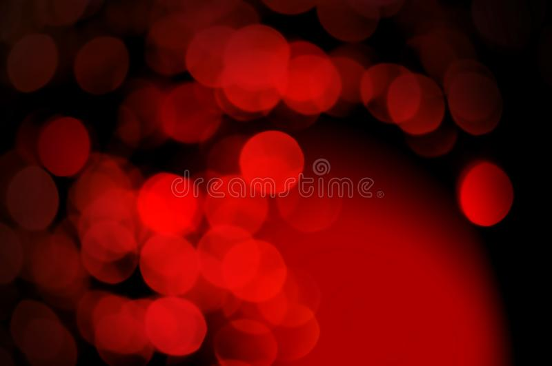 Abstract bokeh red and burgundy color circular background. Christmas light night or season greeting background.Red shining lights, royalty free stock image
