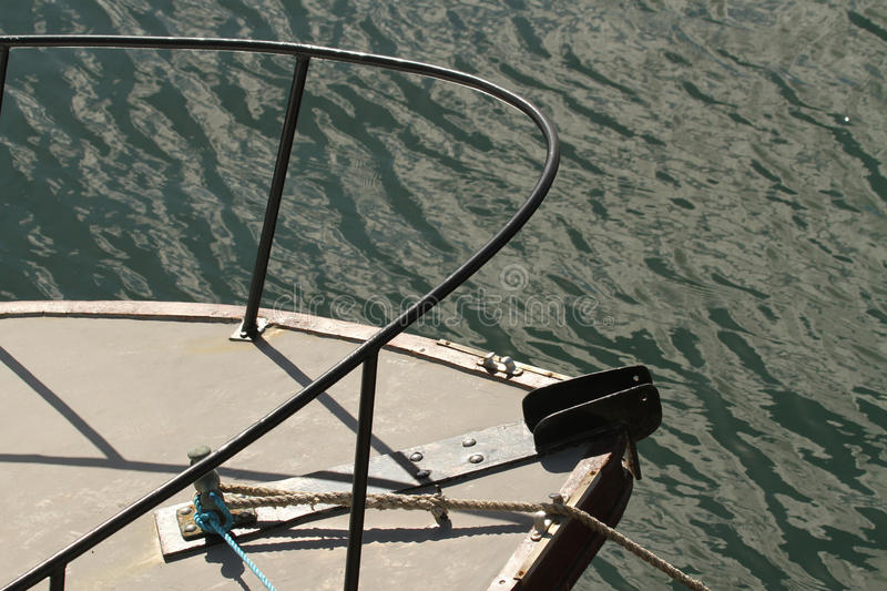Abstract bow of a boat. Abstract partial bow of a boat or sailing yacht in the sea and sun stock photography