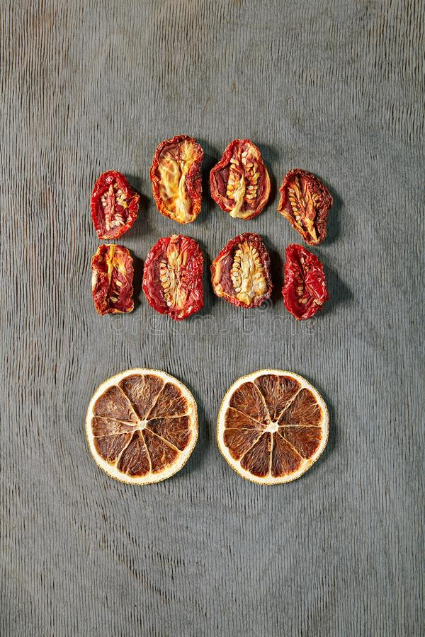 Abstract Brain Monster. Food Art Concept with Abstract Brain Monster made of Dried Orange Slices and Tomatoes Top Vew. Creative Autumn Layout with Eyed Human royalty free stock photography