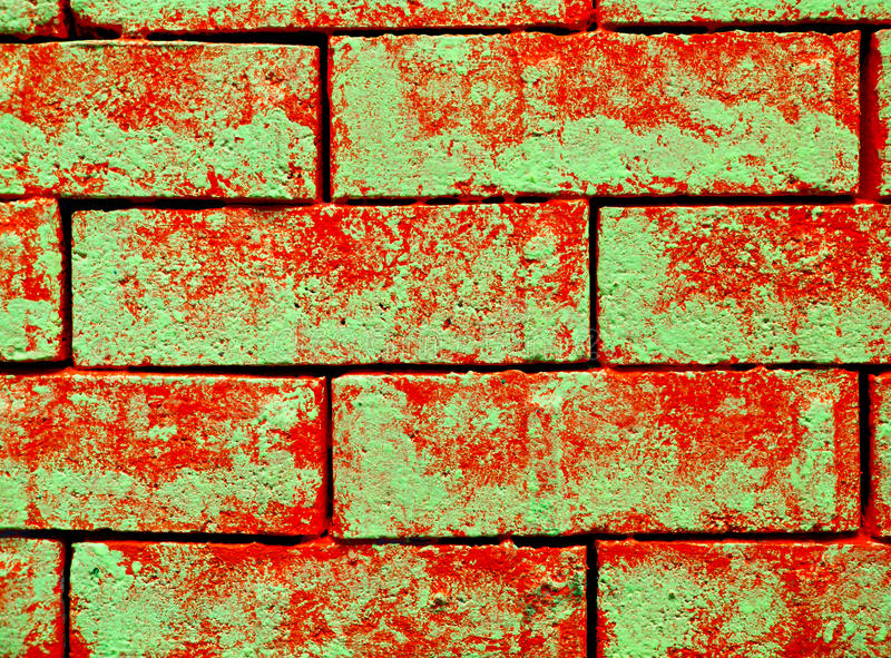Abstract bricks. Abstract red bricks with green glow in the dark paint stock photos