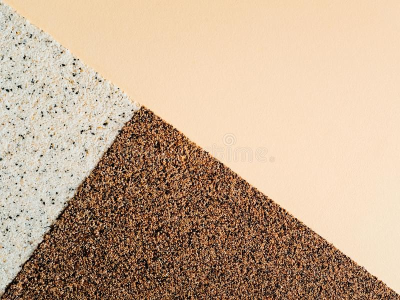 Figure, three triangles in a rectangle with pebbles, grains. Abstract bright background with dots stock photos