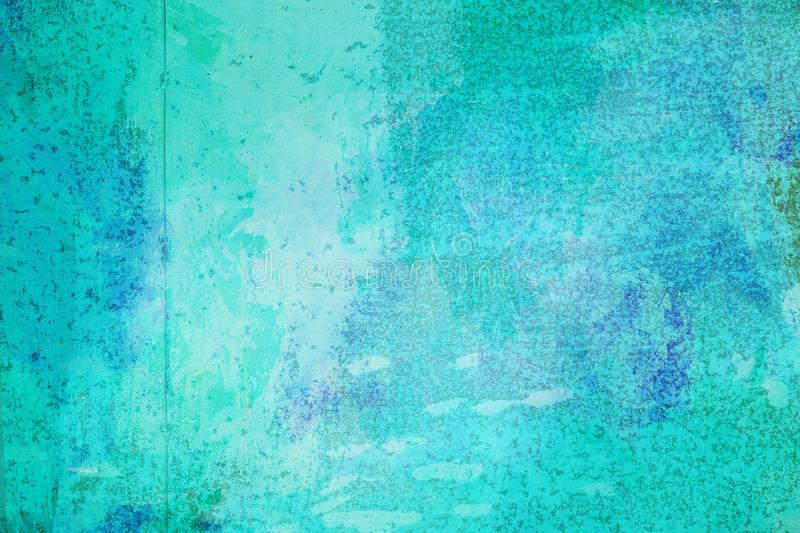 The abstract bright blue surface has a brush painted on the background for graphic design. The abstract bright blue surface has a brush texture painted on the stock photography