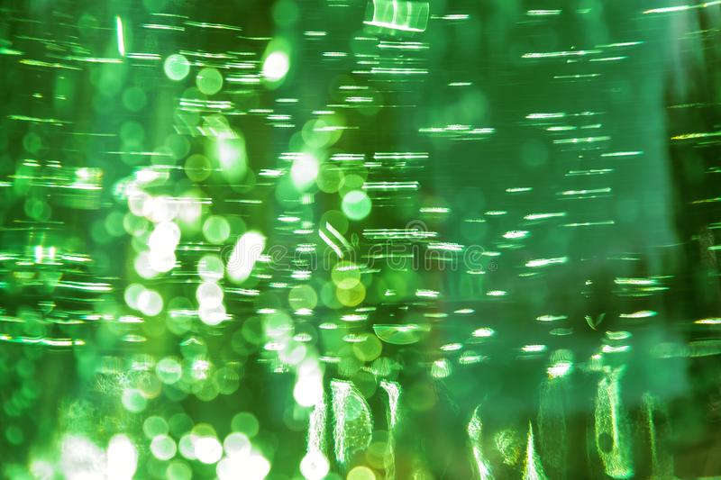 Abstract bright defocused ultra green color shiny background with water texture with bubbles with bokeh effect royalty free stock photo