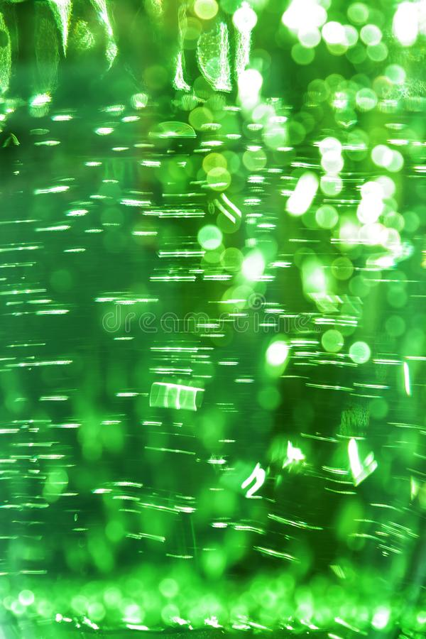 Abstract bright defocused ultra green color shiny background with water texture with bubbles with bokeh effect stock images