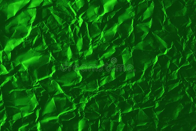 Abstract bright green background of crumpled paper royalty free stock images