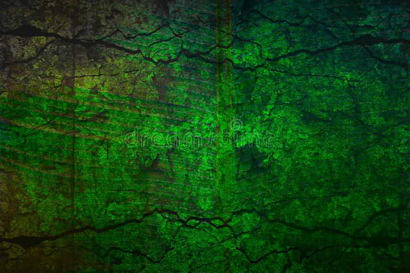 Abstract bright green background in grunge style. The texture of the stone and concrete with cracks royalty free stock photography