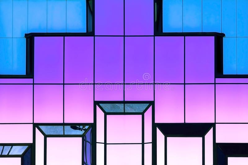Abstract bright modern trendy neon magic geometric shining background with reflection glass texture of a glass mirror surface, stock photos