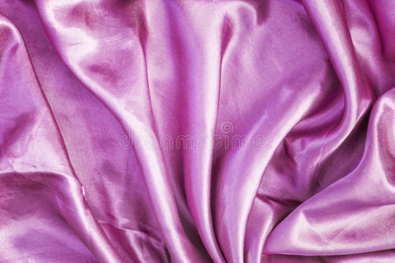 Abstract bright pink background. Smooth silk texture with beautiful folds. royalty free stock photos