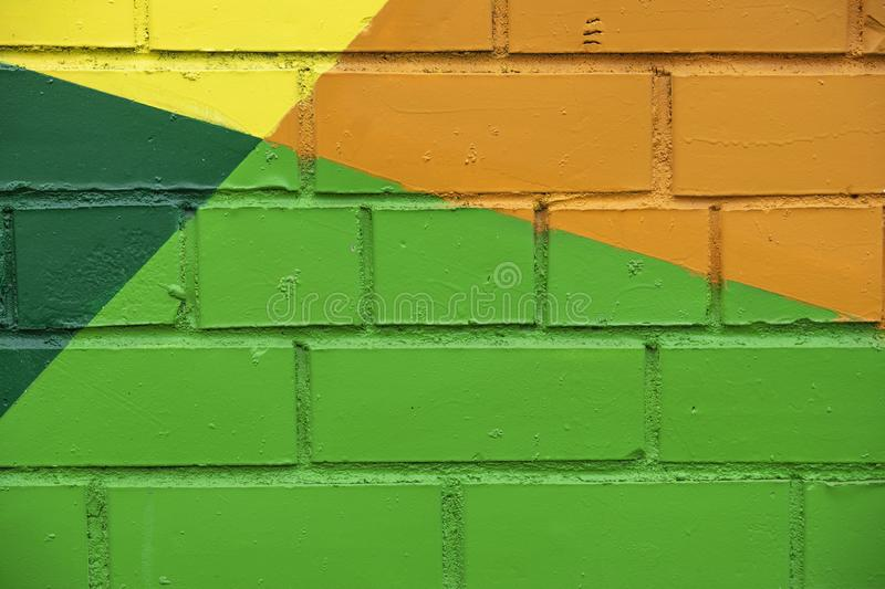 Abstract bright street colorful drawing detail of brick wall, like as graffiti closeup. Can be useful for backgrounds royalty free stock images