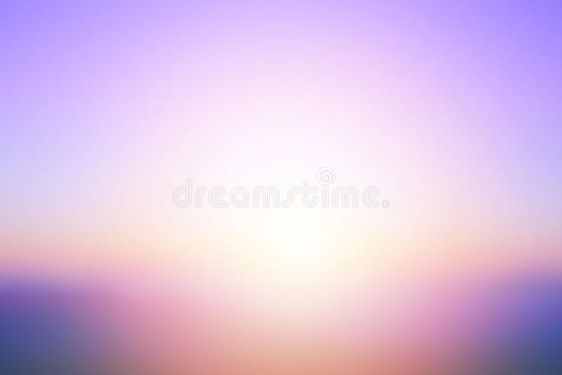 Abstract bright sunset with de focused sun lights blurred background stock image
