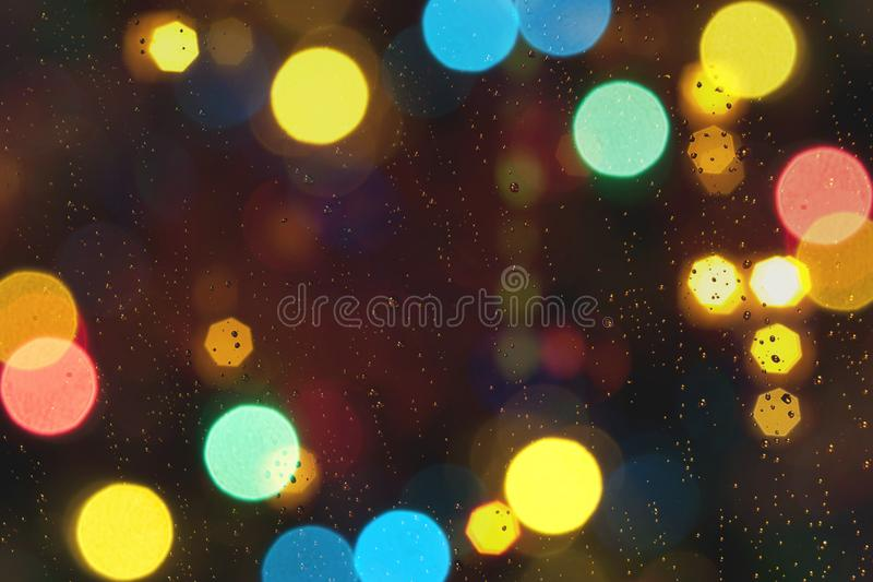 Abstract brown background with blur golden bokeh light effect. royalty free stock image
