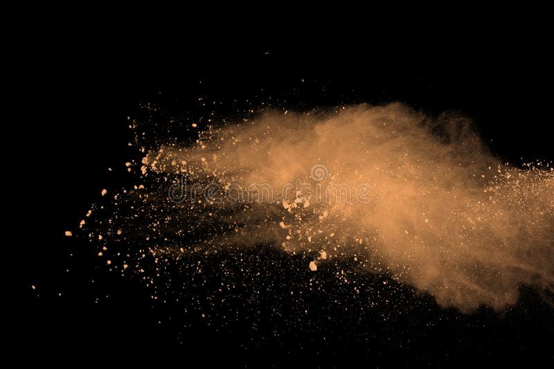 Abstract brown powder splatted background. Colorful powder explosion on black background. Colored cloud. Colorful dust explode. Pa. Int Holi royalty free stock photo