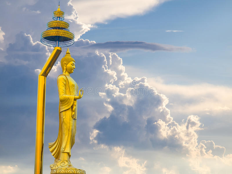Abstract buddha standing in the dramatic storm clouds. stock photos