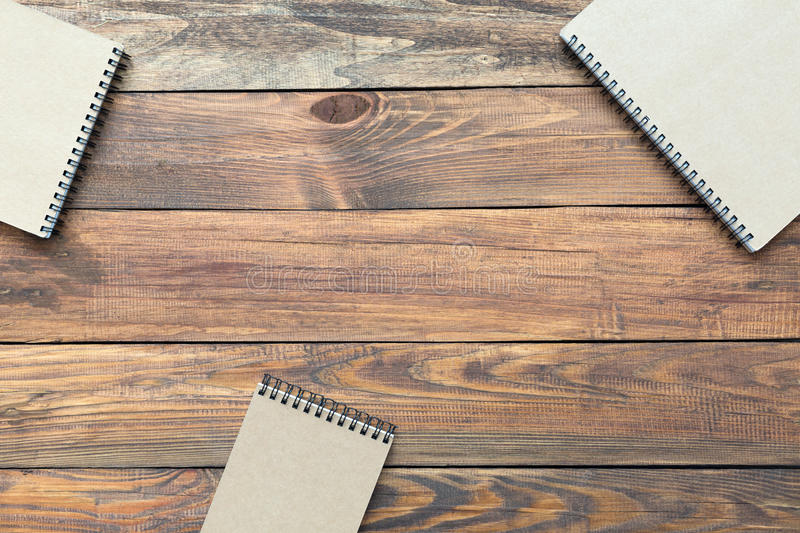 Abstract Business and Lifestyle Composition on Wood. Background three Classic Business and Art style Notepads royalty free stock photo