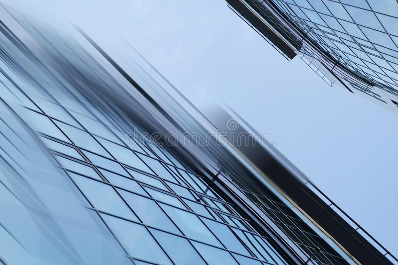 Abstract business modern city urban futuristic architecture background. Real estate concept, motion blur, reflection in. Glass of high rise skyscraper facade stock image