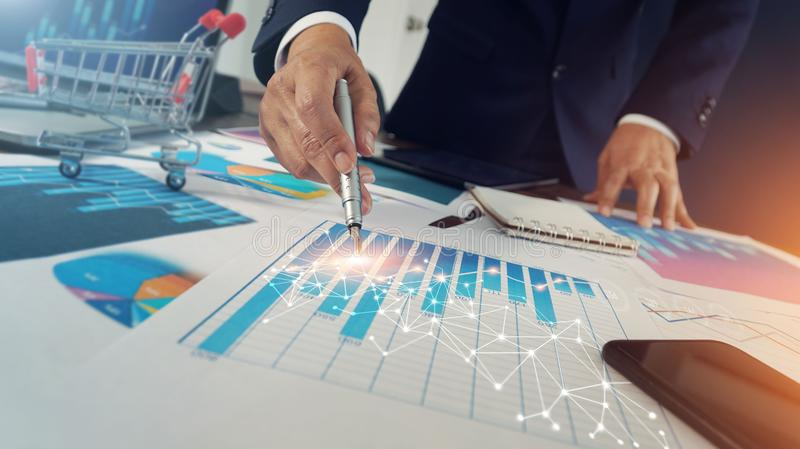 Abstract, Businessman drawing global structure networking  connection on growth graph documents, Business strategy and planning stock photo