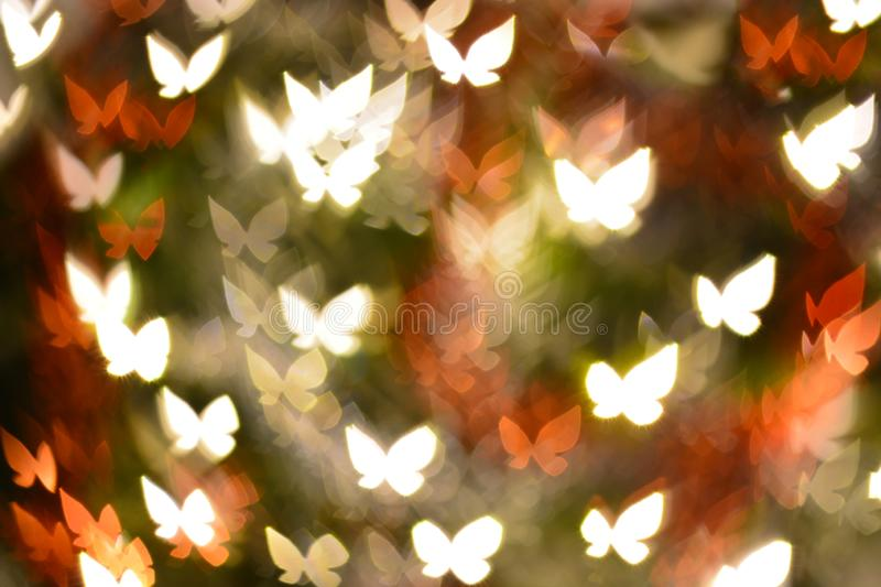 Abstract butterflies shape bokeh for background. Abstract butterflies shape bokeh for texture background beautiful blink blur blurred bright brilliant butterfly royalty free stock image