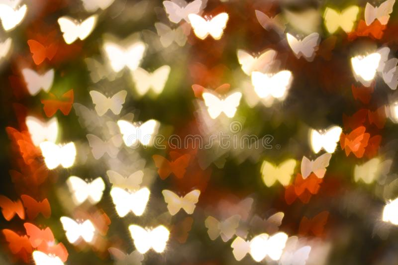 Abstract butterfly shape bokeh for background. Abstract butterfly shape bokeh for texture background beautiful blink blur blurred bright brilliant card carnival royalty free stock images