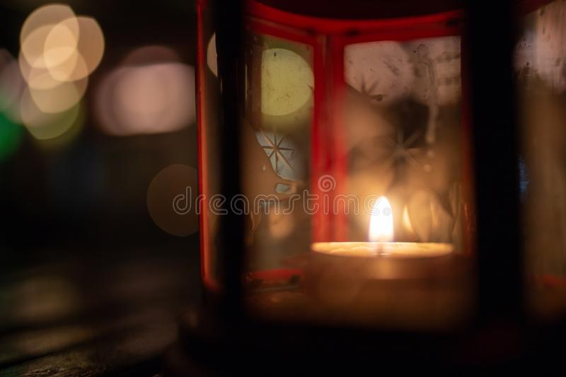 Abstract candle lantern light on wood table in blur bokeh pub re royalty free stock photo