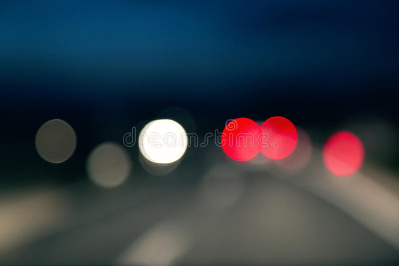 Abstract car light at night. Abstract blurry car light bokeh at night royalty free stock images