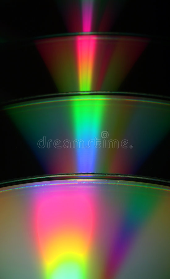 Abstract CDs. An abstract view of CDs refracting light in rainbows stock photo