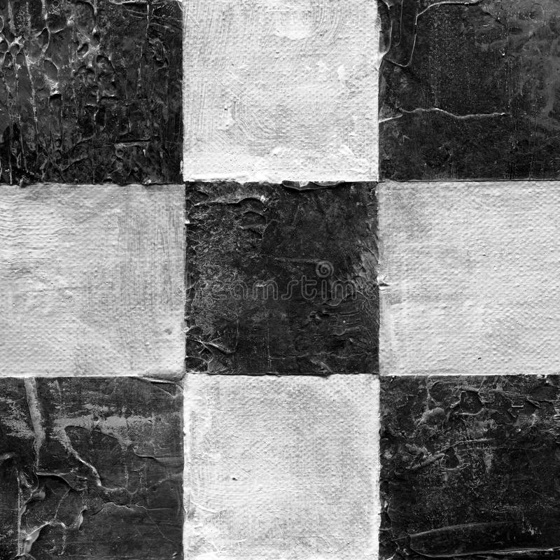 Abstract checkered pattern painted with acrylic or oil paints on canvas in black and white colors. Chessboard with a vintage texture for playing chess. Old stock photo