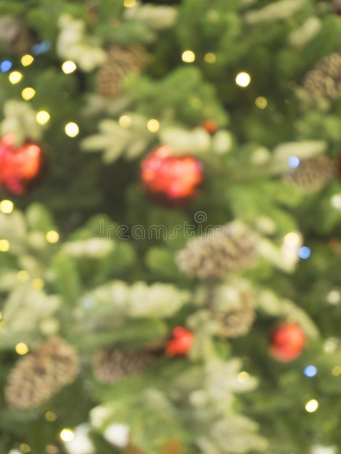 Abstract Christmas background with blurred green Christmas tree. stock photos
