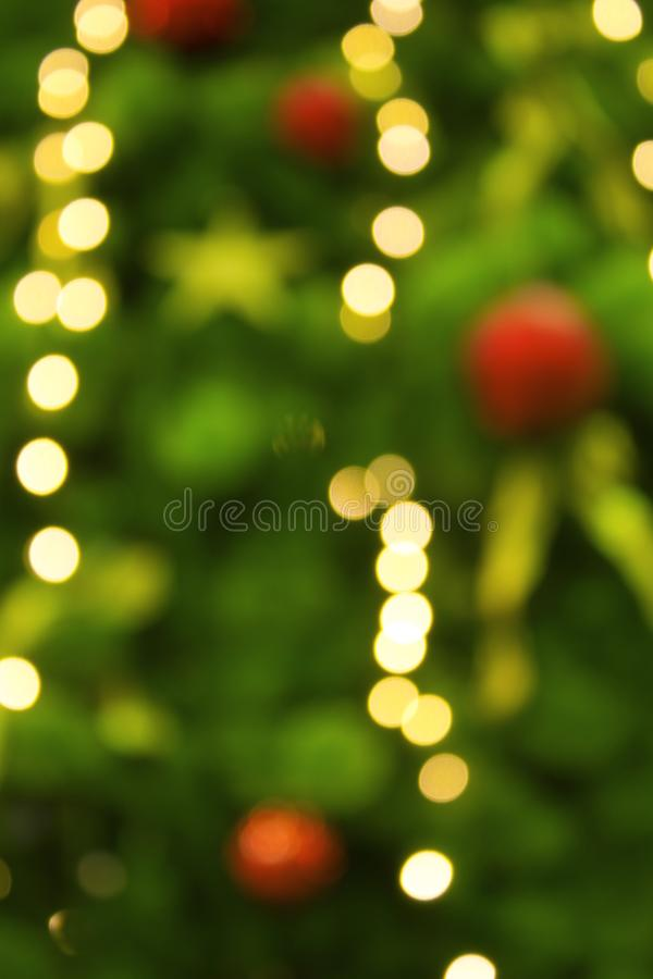 Abstract background with christmas tree with decorations, defocused bokeh lights royalty free stock photo