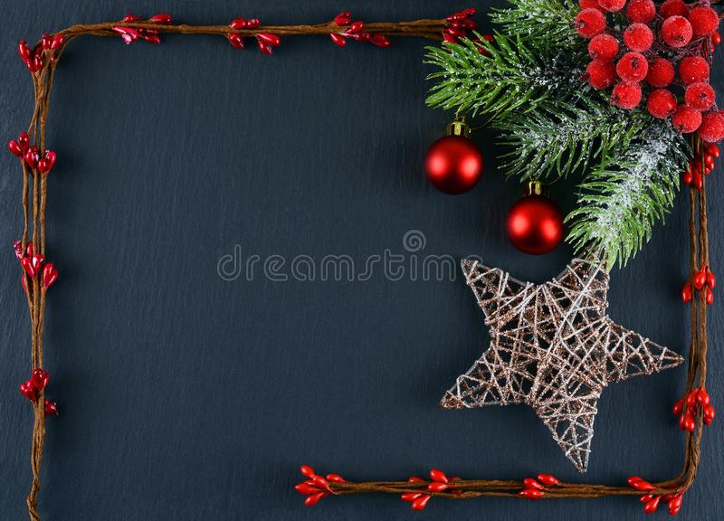Abstract Christmas background and place for text. Christmas background for greeting card or wallpaper. Christmas decorations on a gray background. Abstract royalty free stock photography