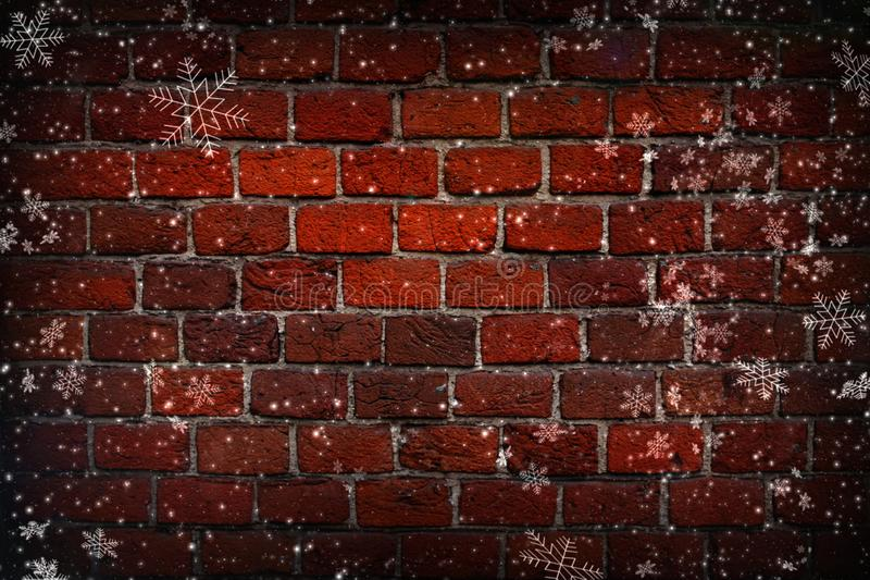 Abstract Christmas background. Red brick wall close-up, texture, background, grunge. White snowflakes on brick wall background. stock image