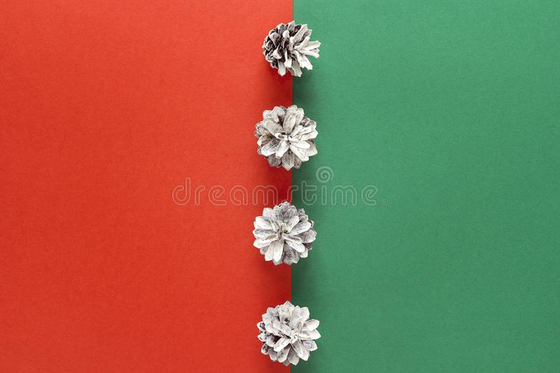 Abstract Christmas background with snow painted pine cones. stock image