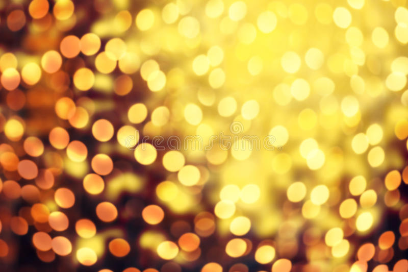 Abstract Christmas glitter vintage lights background. Dark Gold royalty free stock photo