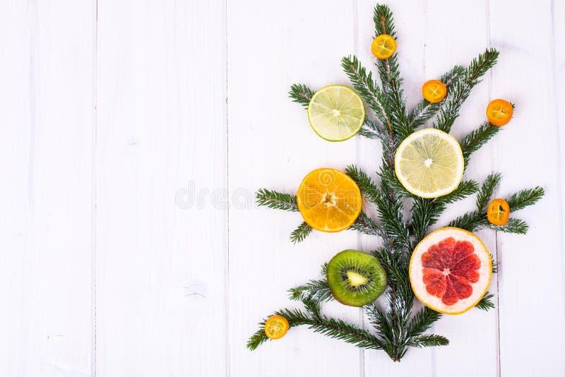 Abstract Christmas tree food background with grapefruit, mandarin, lemon, lime, kumquat royalty free stock photo