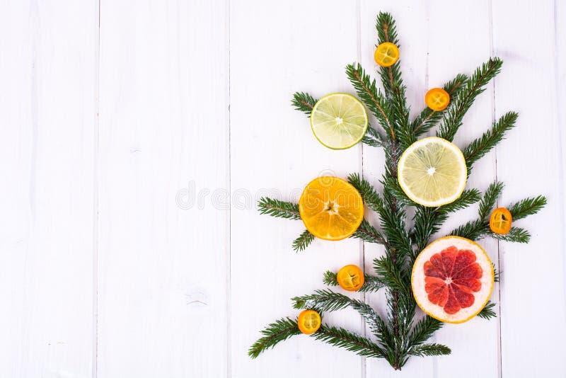 Abstract Christmas tree food background with grapefruit, mandarin, lemon, lime, kumquat stock photos