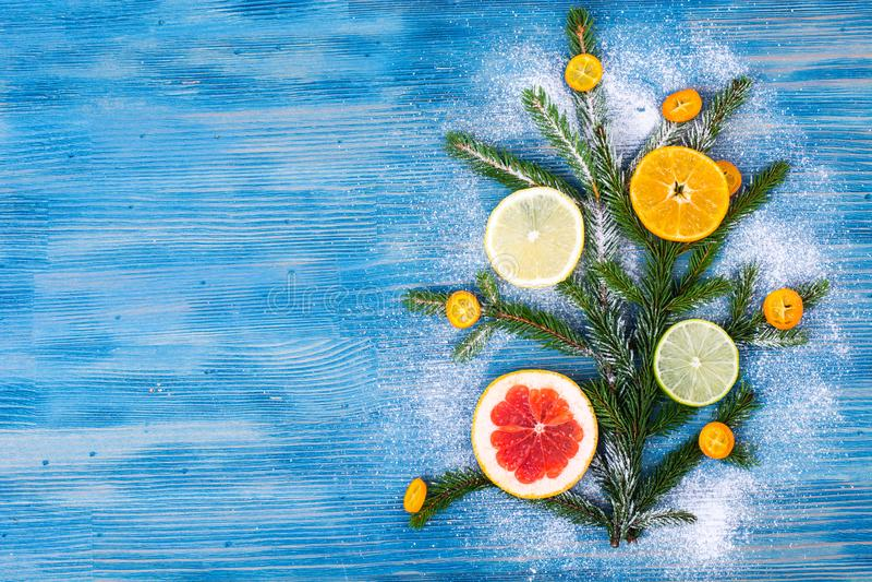 Abstract Christmas tree food background with grapefruit, mandarin, lemon, lime, kumquat royalty free stock image