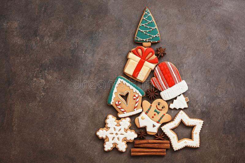 Abstract Christmas tree from gingerbread. Beautiful festive background with various gingerbread cookies. Top view, flat lay, copy stock photo