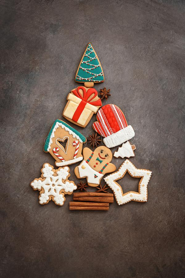 Abstract Christmas tree from gingerbread. Beautiful festive background with various gingerbread cookies. Top view, flat lay, copy stock photography